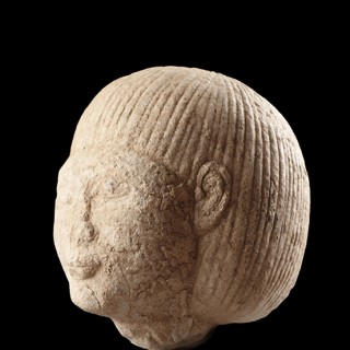 Ancient Egyptian Limestone Head of a Youthful Man with Short Stylised Coiffure