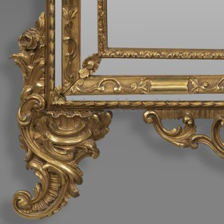 A Finely Carved Rococo Style Giltwood Marginal Mirror With Pierced Cresting