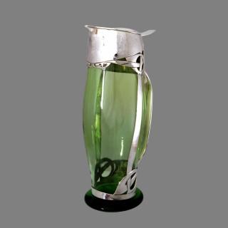 A Liberty Cymric silver claret jug by Archibald Knox