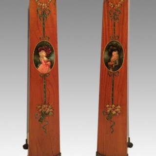 Pair of painted satinwood pedestals.