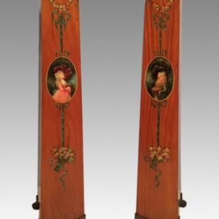 Pair of painted satinwood pedestals.
