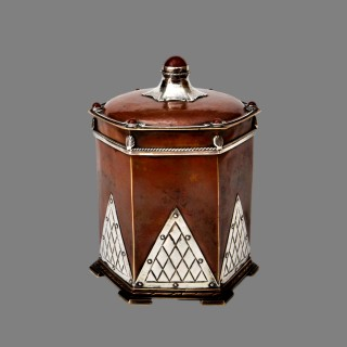 An outstanding, large,  arts and crafts silver, copper and carnelian tea caddy