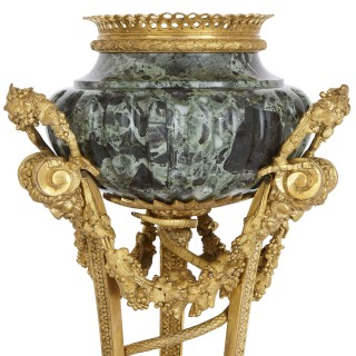 Two gilt bronze mounted Verde Antico marble urns after Gouthière