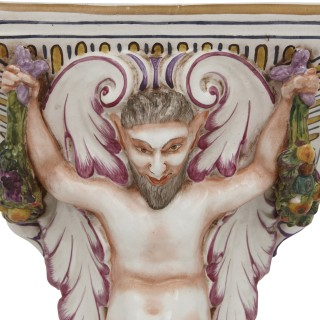 Four decorative porcelain wall brackets of satyr form