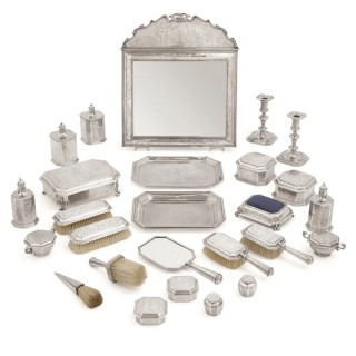 English Chinoiserie style twenty-six-piece silver toilet service