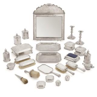 English Chinoiserie style twenty-six-piece silver toilet service