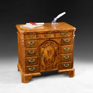 An extremely rare Queen Anne period walnut crossbanded and feather banded Kneehole Desk