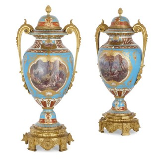 Two gilt bronze mounted porcelain vases with hunting paintings