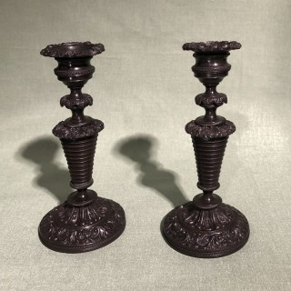 A pair of early 19th Century French bronze Candlesticks.