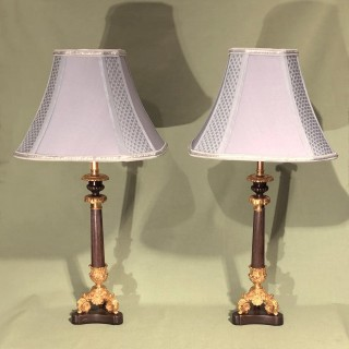Pair of mid 19th Century Bronze and Ormolu Triform Candlestick Lamps