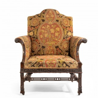 A late Victorian oversized arm chair in the Chippendale manner