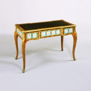 A Porcelain mounted Bureau Plat in the Manner of Edward Holmes Baldock