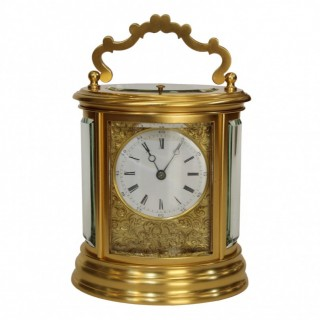 Antique oval striking carriage clock by Drocourt