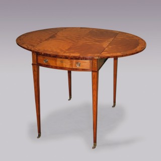 A late 18th Century Sheraton period Satinwood Pembroke Table.