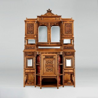 A Magnificently Carved Display Cabinet  Of Exhibition Quality