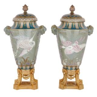 Two Sèvres gilt bronze mounted porcelain pâte-sur-pâte vases by Gely