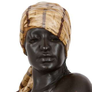 Two Orientalist terracotta bust sculptures of Nubian figures by Thiele