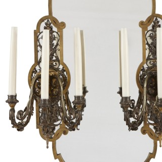 Two Rococo style gilt and silvered metal girandoles