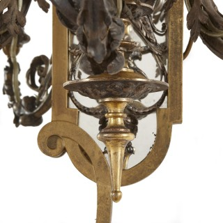 Two Rococo style gilt and silvered metal girandoles
