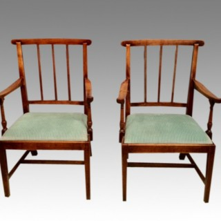 A pair of country  Georgian fruitwood armchairs.