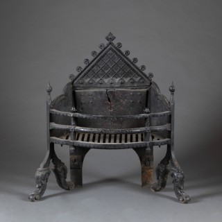 A 19th century  English 'Gothic' wrought iron firegrate