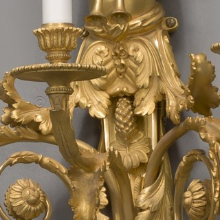 A Pair of  Louis XVI Style  Gilt-Bronze Three-Light Wall-Appliques