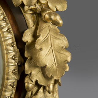 A Louis XVI Style Mahogany  Cartel Clock and Barometer