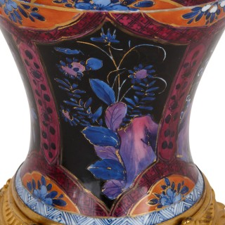 Two Chinese Qing dynasty porcelain vases with gilt bronze bases