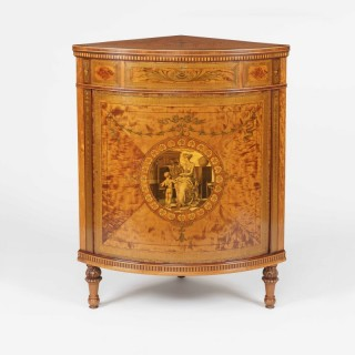 A Fine Corner Cabinet Firmly Attributed to Maples & Co