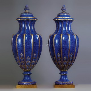 A Rare Pair of Lapis Lazuli Ground Decorated Sèvres Porcelain Vases and Covers