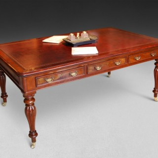 A mid 19th. Century mahogany partners writing table