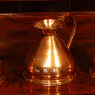 A collection of 3 Victorian copper measures
