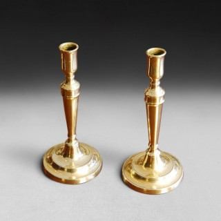 Pair of George III Period Brass Candlesticks in the Neo-Classical manner