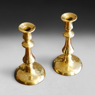 Pair of Mid 19th. Century Brass Candlesticks with circular bases