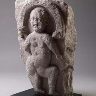 Rare Irish Celtic Limestone Slab Carved with a Relief of a Youthful Dancing Deity