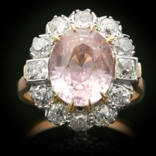 Padparadscha sapphire and diamond coronet cluster ring, circa 1915.