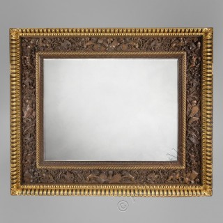 A Finely Carved Florentine, Renaissance Revival, Walnut and Parcel-Gilt Mirror