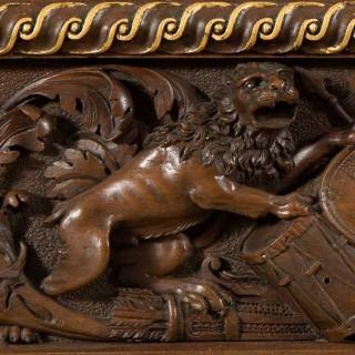 A Finely Carved Florentine, Renaissance Revival, Walnut and Parcel-Gilt Mirror