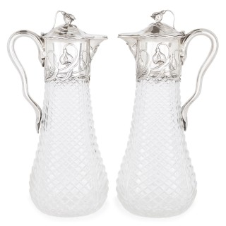Two Art Nouveau silver and cut glass claret jugs by Wilhelm Binder