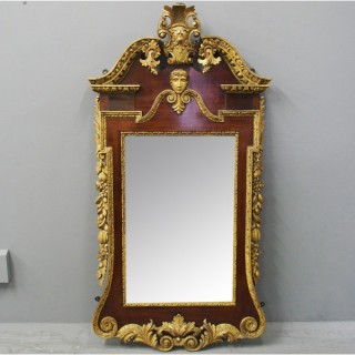 George II Style Carved Walnut and Gilded Mirror
