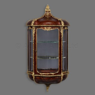A Matched Pair of Louis XVI Style Gilt-Bronze Mounted Wall Vitrines
