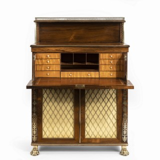 A Regency brass-inlaid rosewood secretaire cabinet 1810