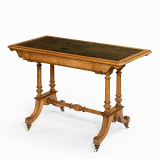 A Victorian birch or satinwood writing table, attributed to Holland and Sons