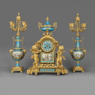 A Napoléon III Gilt-Bronze and Turquoise Porcelain Clock Garniture