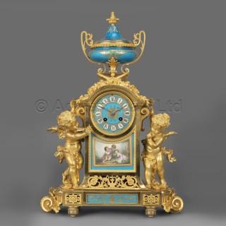 A Napoléon III Gilt-Bronze and Turquoise Porcelain Clock Garniture