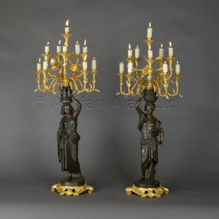 A Pair of Gilt and Patinated Bronze Figural Candelabra