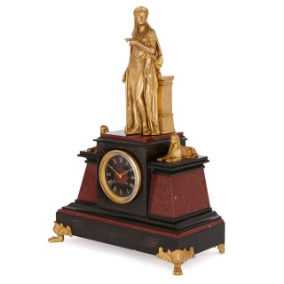 Antique Egyptian Revival style marble and gilt bronze clock set
