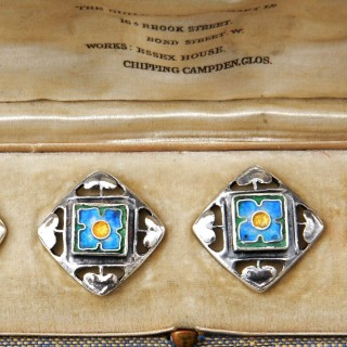 A boxed set of Guild of Handicraft silver and enamel buttons