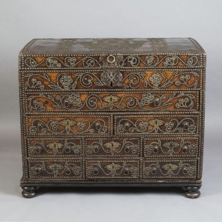 A STUART STUDDED CHEST WITH DRAWERS