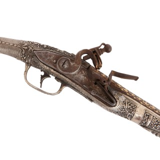 Two antique silver and gold-damascened holster pistols